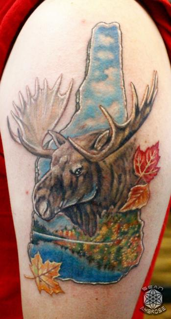 Custom realistic colorful New Hampshire Moose Mountain tattoo by Sean Ambrose of Arrows and Embers Tattoo in Concord, New Hampshire (NH). Sean specializes in realism and surrealism custom Tattoos. He has been awarded as the Best Tattoo Artist in NH multiple years from multiple publications, and also won handfuls of awards for his tattoos and art.