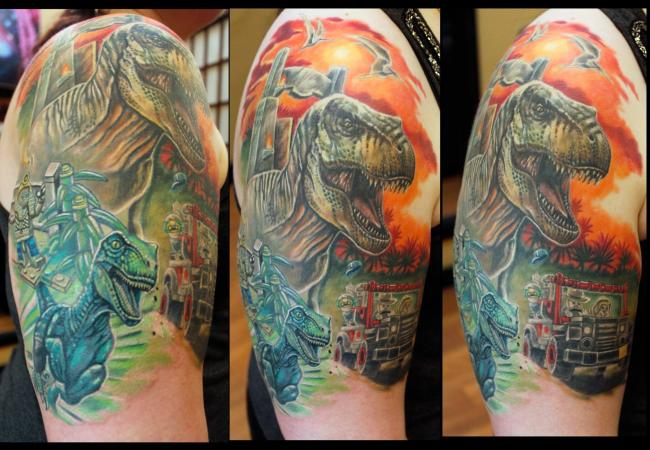 Custom realistic colorful Lego Dinosaur (Raptor) tattoo by Sean Ambrose of Arrows and Embers Tattoo in Concord, New Hampshire (NH). Sean specializes in realism and surrealism custom Tattoos. He has been awarded as the Best Tattoo Artist in NH multiple years from multiple publications, and also won handfuls of awards for his tattoos and art.